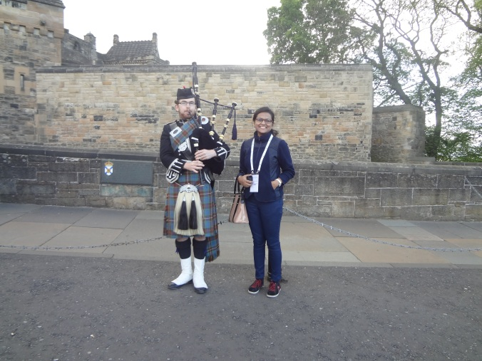 Me with a bagpiper at the Edinburgh Castle conference reception
